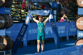 Alec Davison crossing the finish line first at the ITU Cross Triathlon World Championships.