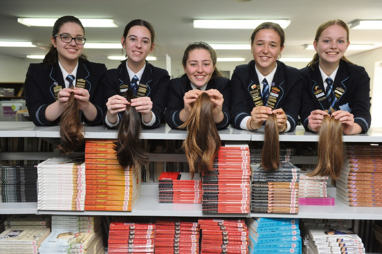 Kind of MADness: Year 12 Iona students (l-r) Caitlyn Sabatini, Hannah Howard, Maddy Smyth, Sofie Osborne and Meg Hampton lopped their ponytails for charity. Picture: Jon Bassett