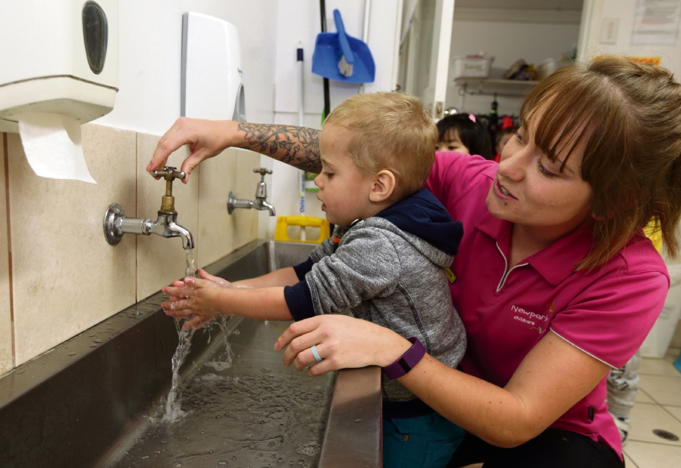 Childcare worker Tegan Cammeron-Dow helps her son Dewi (2) to wash his hands correctly. Picture: Martin Kennealey www.communitypix.com.au   d473147