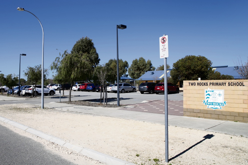 The Education Department says Two Rocks Primary School's parking compares favourably to other schools, despite complaints from parents.