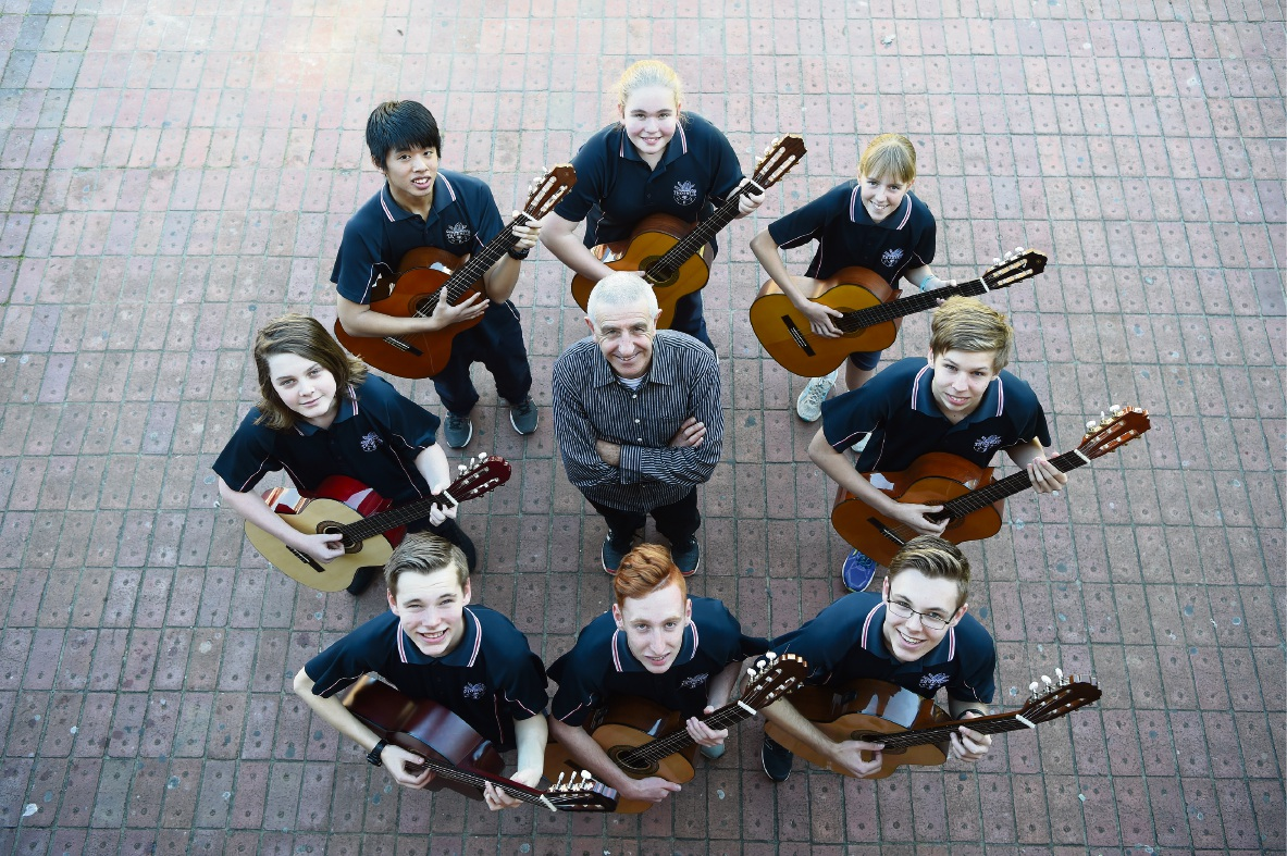 Classical guitar teacher Joe Bonini with students Eden Wood, Jet Chew, Bonnie Ward, Hayley Colvin, Luke Darrington, Liam Burke, Joe, Hayden Burke and Rafael Sheppard. Picture: Jon Hewson www.communitypix.com.au   d473188