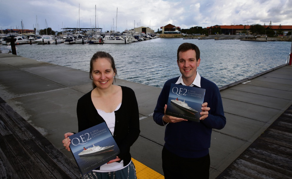 Rachelle Cross and Chris Frame with a copy of the latest book on the QE2.  Picture: Martin Kennealey  d473363