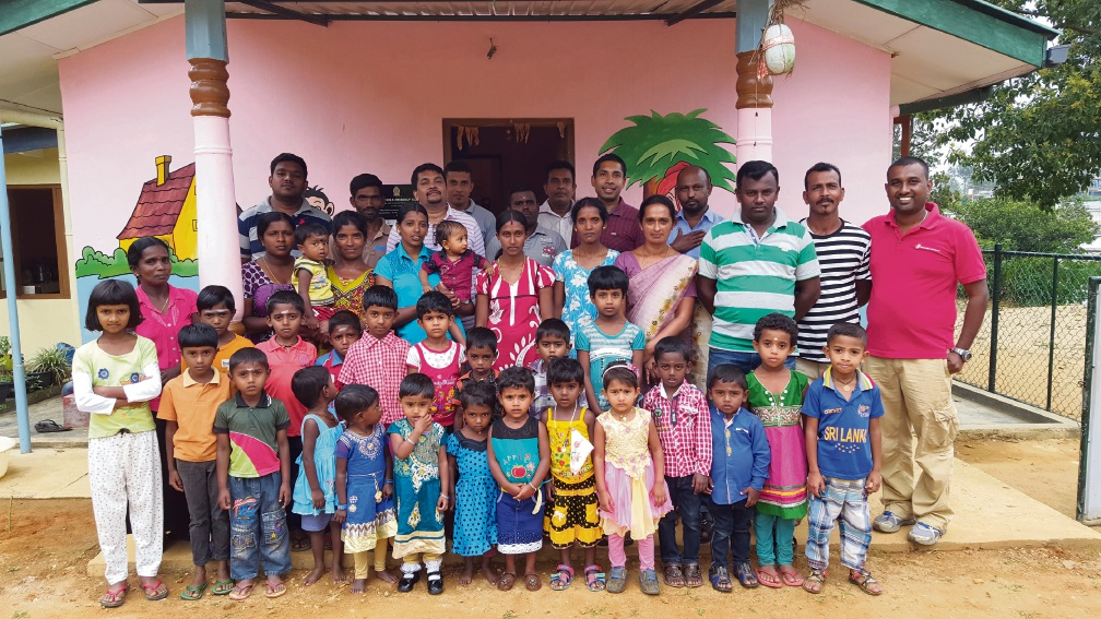 Save the Children staff with the children and carers in Sri Lanka.