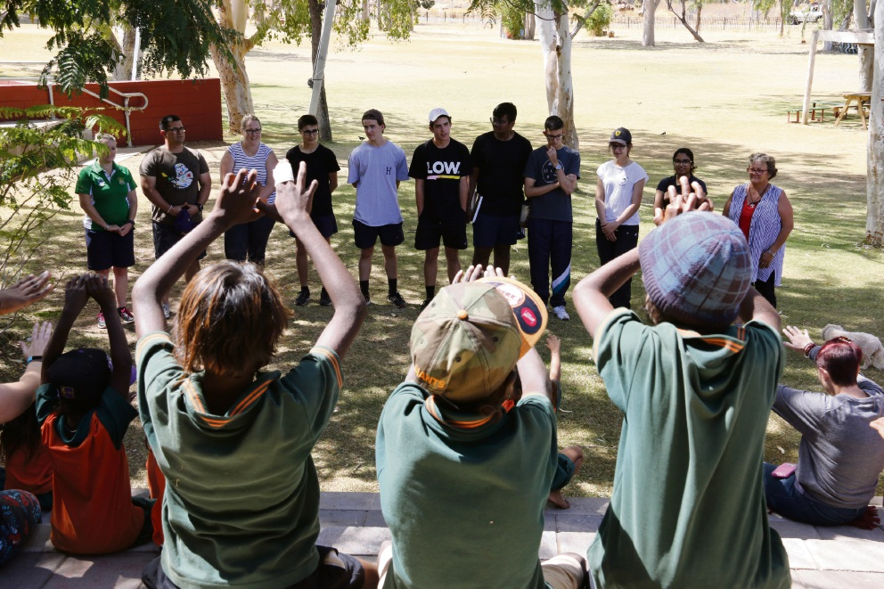 Emmanuel Catholic College students have fun with young students from Warmun.