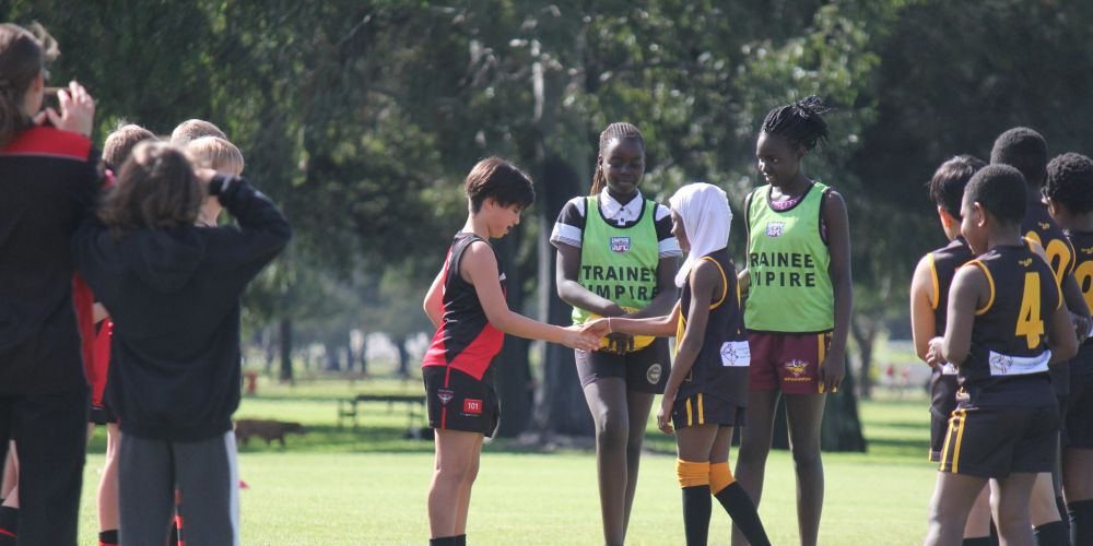 Edmund Rice Young Lions Captain Fatoumata Toure with ERCWA umpires Joice Tabaga and Aker Athoi ahead of their the Lions clash with the Coolbinia Bombers. Picture: ERC Youth Leaders