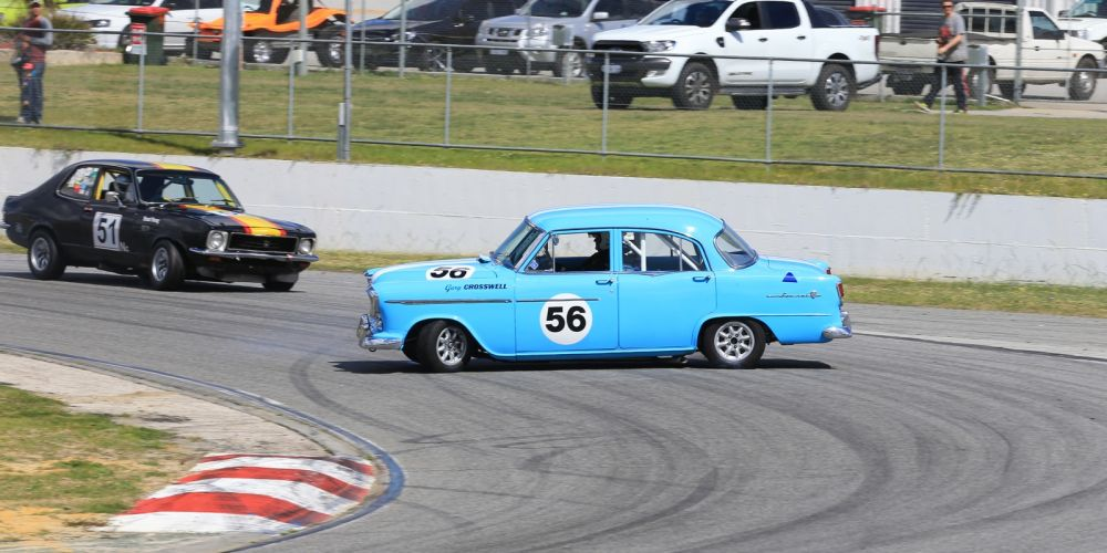 Gary Crosswell's Holden FE does an unplanned 360 in front of Stuart Young. Pictures: Travis Barnes