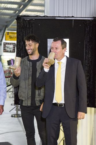 Daniel Ricciardo and Mark McGowan enjoy a 'shoey'.
