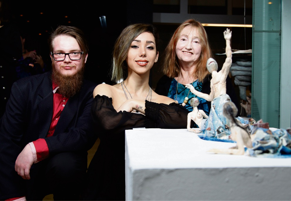 Callam Williams, Leyla Sharifi and Sandra Fisher sitting behind Leyla's piece Fishmen Ceramic piece by Callam Williams Towards the Hurricane. Picture: Marie Nirme