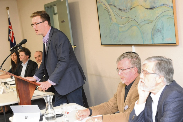 Mosman Park North Ward candidate Andrew Wilson (left) continued his crime campaign, with (l-r) Cr Brett Pollock and Mayor Ron Norris listening, at the town hall meeting: Picture: Jon Bassett.