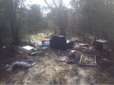 The rubbish dumped on the land.