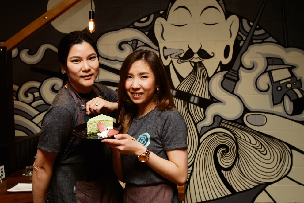 Por Ju and Gif Si with a Pandanus Crepe Cake at Bangkok Brothers. Picture: Marie Nirme d474221