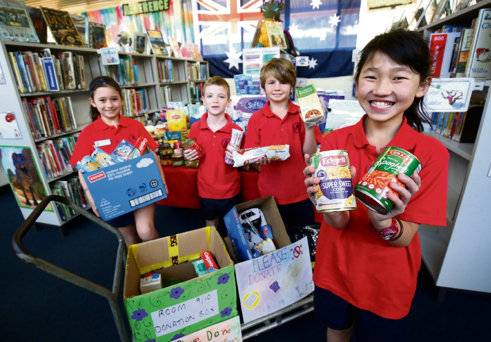 Hayley Gibson, Joshua Jones, Lachlan Braid and Kai Wei Tey  with some of the donations for the Salvation Army. Picture: Matt Jelonek www.communitypix.com.au   d473993