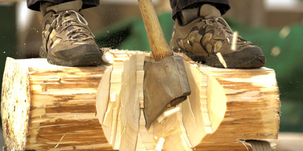 lumberjack chopping a log with an axe in a contest