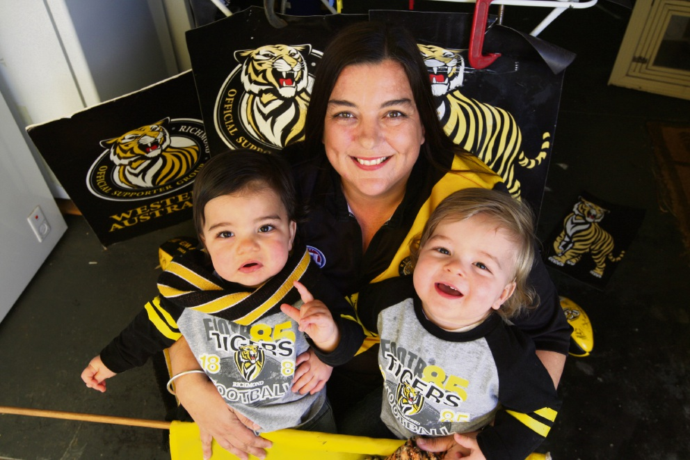 Rachel Kemp with her 14-month-old twins Jack and Max Brooks.