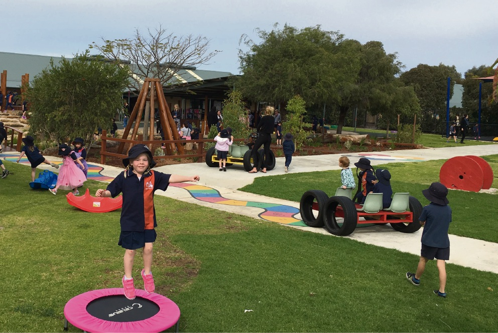 Kindergarten students Luca Seeber (front) and Emilia Hickman in the nature playground.