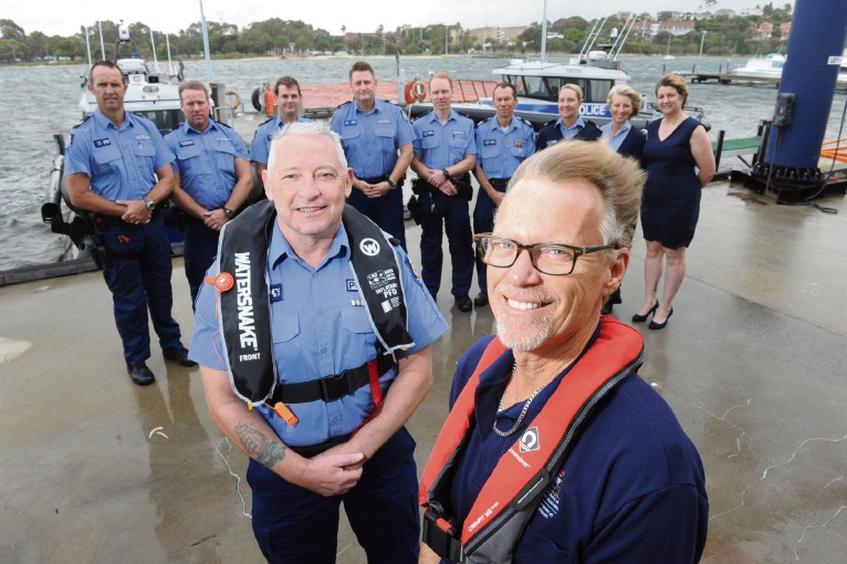 Department of Transport safety education manager Laurie Adams (right) and Water Police led by Senior Sergeant Noel Minnock want boaties to wear modern lifejackets. Picture: Jon Bassett