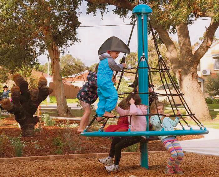 Children playing on the new nature playground at Dixon Park.