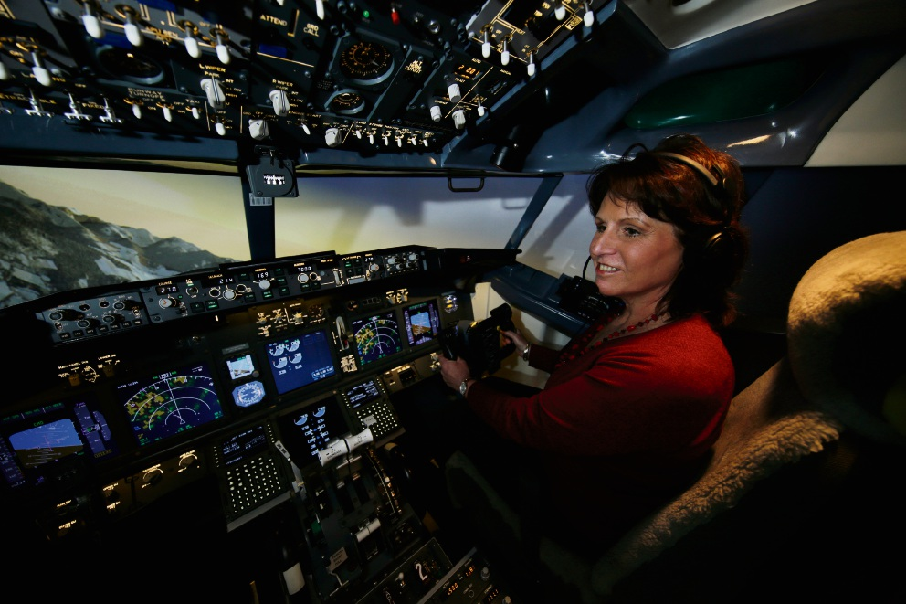 Attadale resident Valerie Arrowsmith behind the controls of a Boeing 737 at Flight Experience's flight simulator. Picture: Andrew Ritchie www.communitypix.com.au d474321