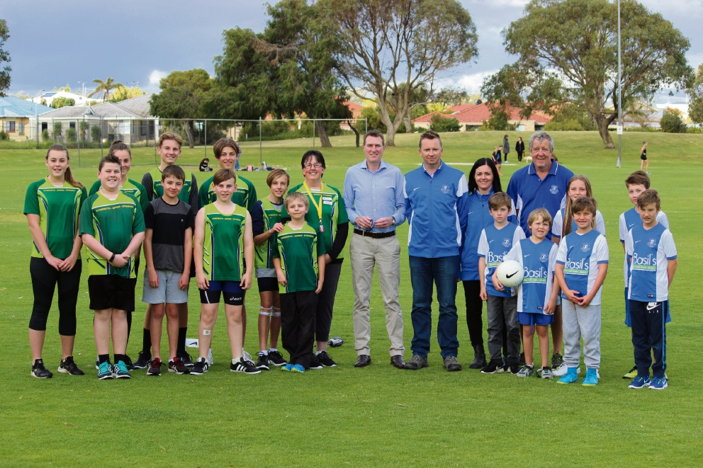 Pearce MHR Christian Porter with Nicole James and representatives from Mindarie Mustangs Little Athletics and Neil Gornell and representatives from Mindarie FC.