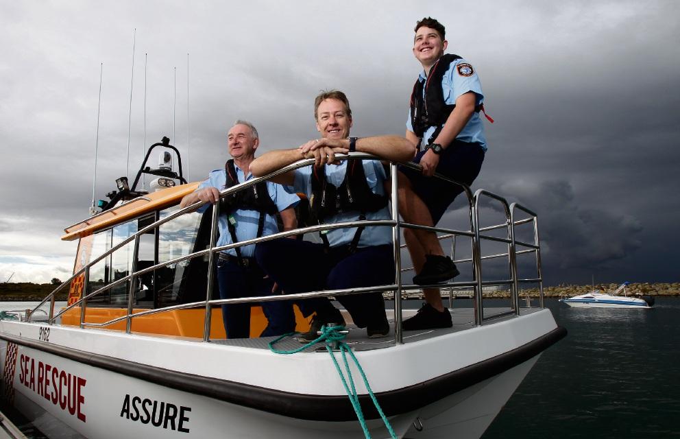 Commander Brad Nicholas, Crew Member Lachlan and Brain on the newest vessel in Cockburn Sea Rescue's fleet.