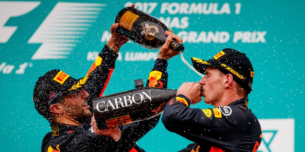 Race winner Max Verstappen celebrates with third place finisher Daniel Ricciardo.  Picture: Lars Baron/Getty Images
