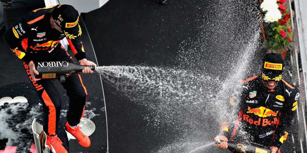 Race winner Max Verstappen celebrates with third place finisher Daniel Ricciardo.  Picture: Mark Thompson/Getty Images