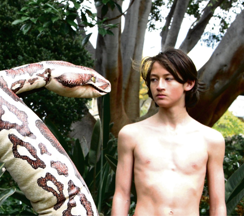 Kaa (puppeteered by Charlie Young) and Mowgli (Jamie Buttery).