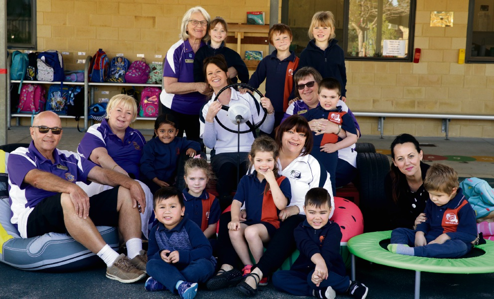 Graham Dore, Suzanne Dore, Glenys Fricker and Sue Mcdonald from Wanneroo Lions Club with education assistants Chantelle Watts, Lisa Brooker, Samantha Lear and students. Picture: Martin Kennealey d473898