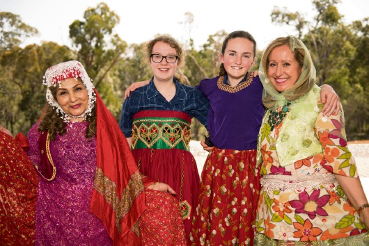 Year 8 students Kiah Watson (left) and Elizabeth Zuber-Watts (right) with Shahla Haidary and Parvaneh Haidary. Picture: Chris Jeffrey/Helena College.