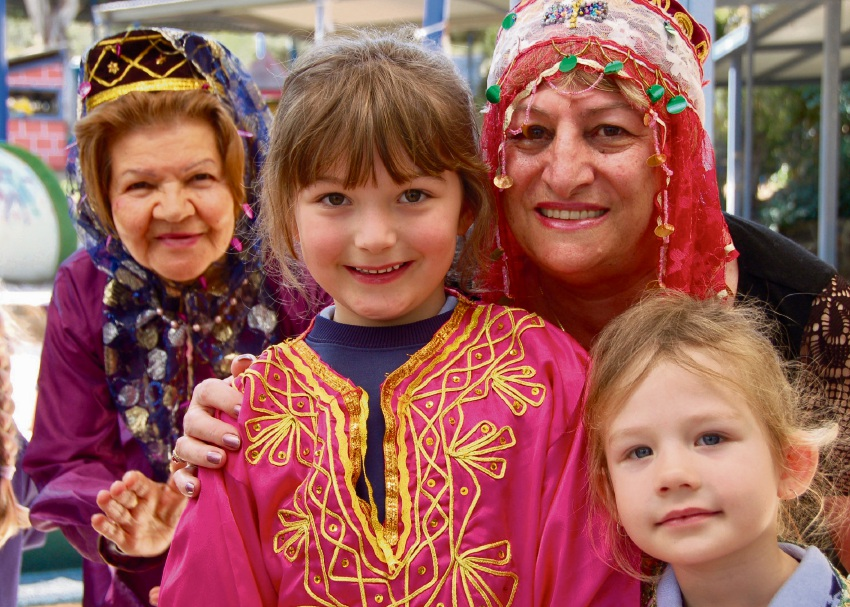 Helena College early learning centre students Chloe Stamenich (middle) and Neveah Casey (right corner) with Narges and Faeze Ghorbanian. Picture: Chris Jeffrey/Helena College