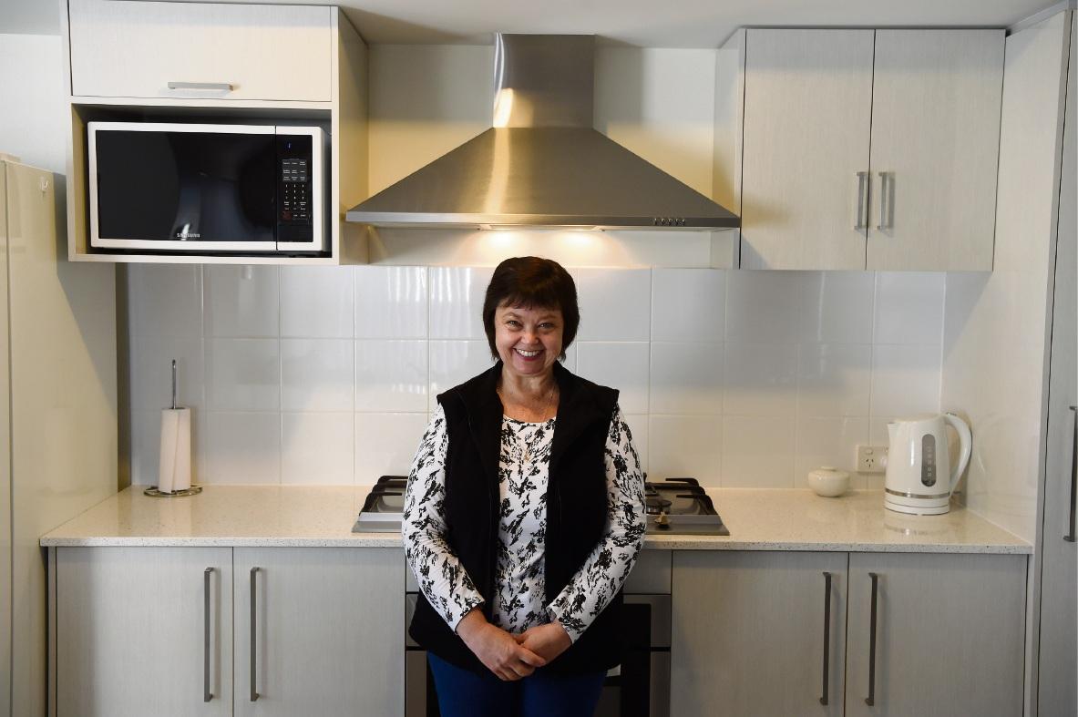 Louisa Spangenberg in her new kitchen. Picture: Jon Hewson www.communitypix.com.au   d473869