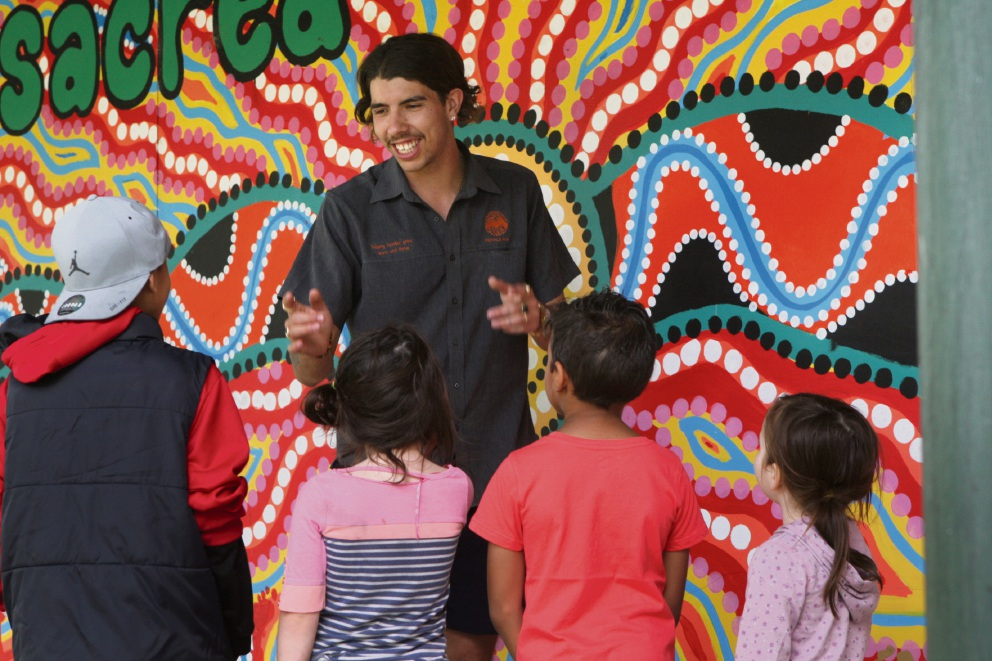 Matthew Bill spins a yarn to local children in his group. Picture: Bruce Hunt d474455