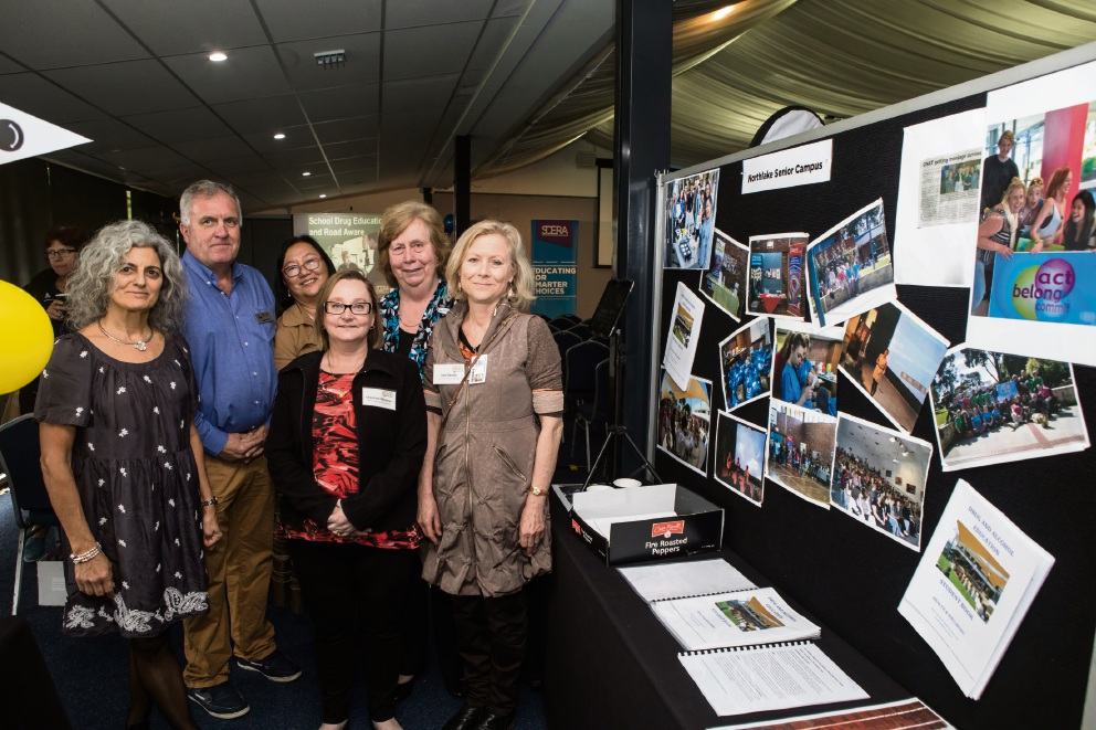 North Lake Senior Campus staff Nadia Lekias, Andre Guci, Linda Kwok, Christine Menner, Mary Margetts and Jane Beatty with their school display.