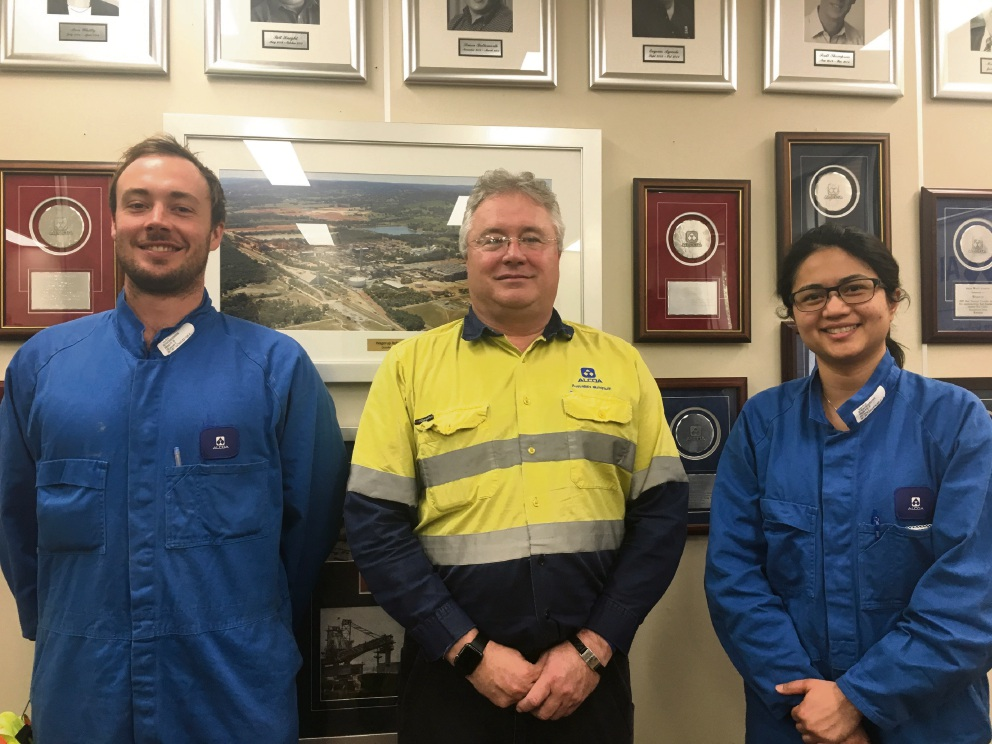Alcoa's Wagerup refinery manager Mark Hodgson congratulates new trainees Samual Jacques and Audrey Wong.