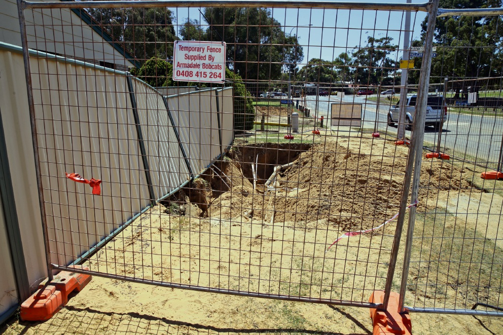 The sink hole, now fenced off. Picture: Martin Kennealey