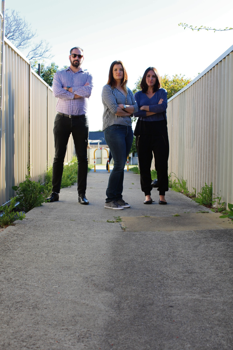 Piedmont Court residents Sam Smith, Telisha Rhodes and Belinda Stagoll are concerned about anti-social behaviour in a nearby laneway. Picture: Kate Leaver