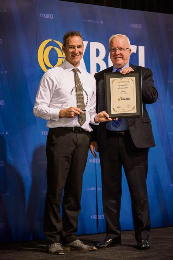 WT Hydraulics director Kraige Cooper (left) receives his company's award.