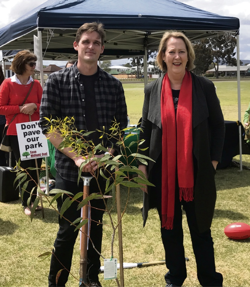 Tim Clifford and Michelle Roberts plant a tree to smbolise the community's wish to keep the Midland Oval as a public green space.