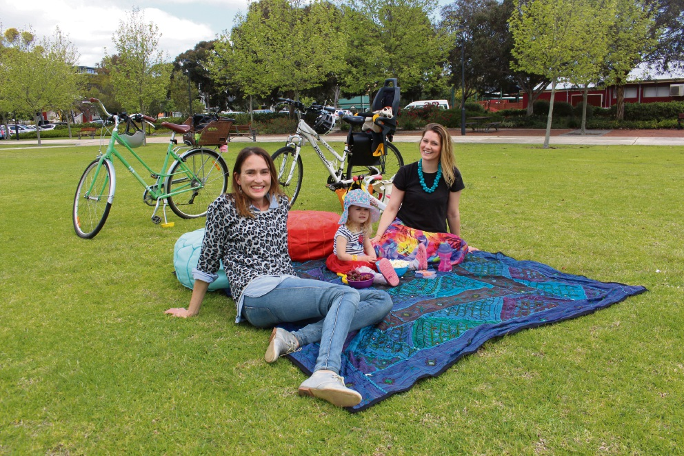 South Perth Activation Network members Lisa Rooke and Julie Rougier-Lagane with her daughter Stella, are encouraging people to a pop-up cinema event.
