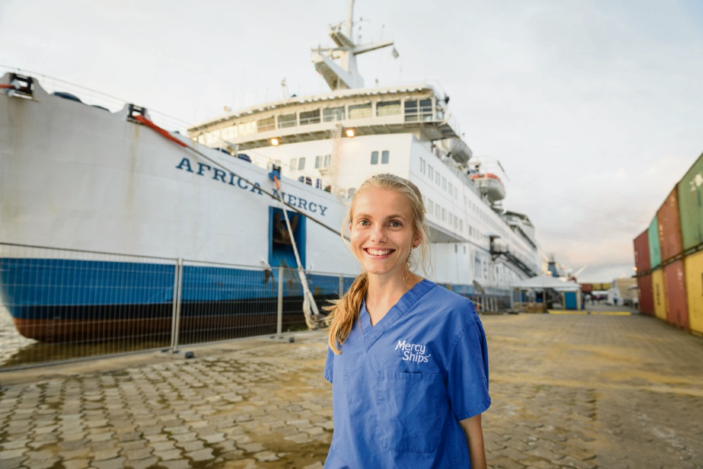 Sarah Sim beside the African Mercy in Cameroon.