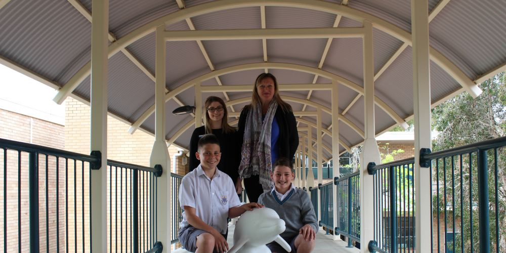 Trinity College school psychologist Amber Newsome, The Big Splash WA Coordinator Deidre Whiston with students Taj McCartney and Jacob Wilkie.