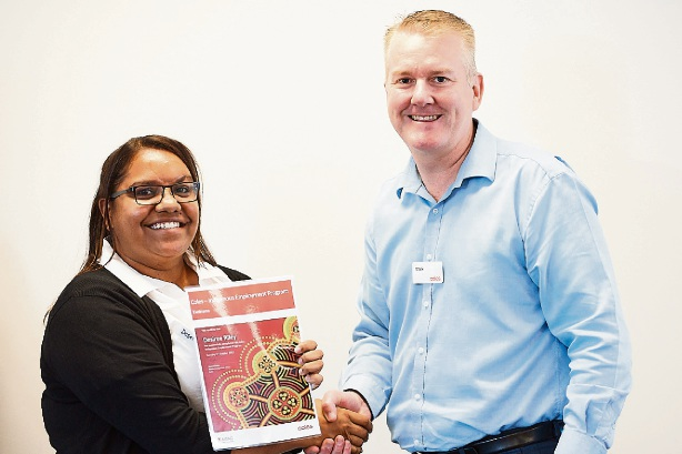 New Kwinana Coles First Steps employee Desiree Riley with Mark O'Connor.