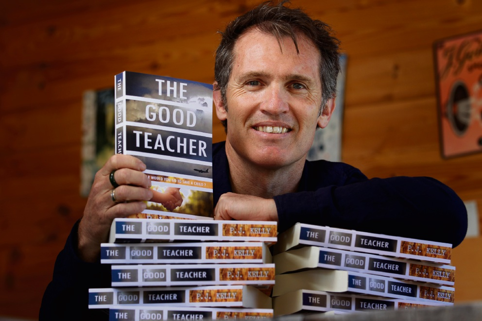 Teacher and author P.J. Kelly with his first book The Good Teacher. Picture: Marie Nirme www.communitypix.com.au   d474335