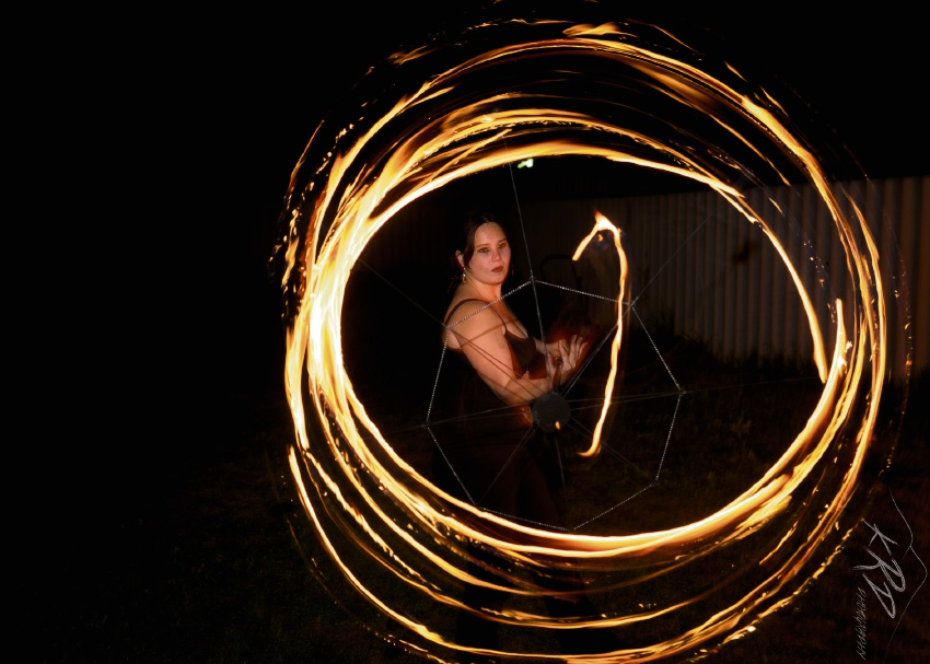 Fire spinner Taralee Caine. Picture: KRD Photography