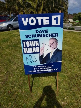 One of Mandurah councillor Dave Schumacher's vandalised signs.