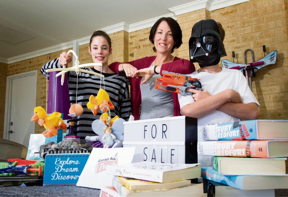 Lisa Reed with her children Madison (16) and Dylan (12) preparing for the Garage Sale Trail. Picture: Marie Nirme d474710