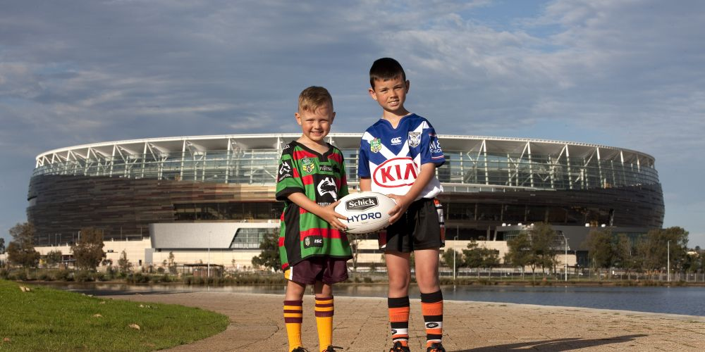 Joondalup Giants' Parker Pearson and Alkimos Tigers' Isaac Coorey at Perth Stadium.