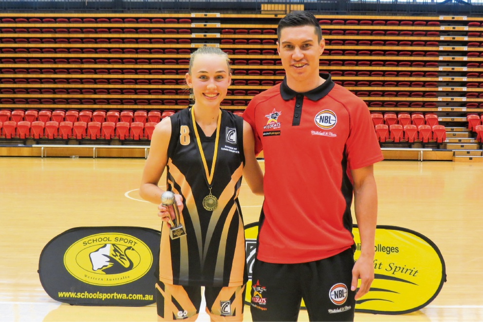 Corpus Christi College Year 11 student Carla Drennan was presented with the MVP award by Perth Wildcats player Jarrod Kenny after leading the Associated and Catholic Colleges All Stars to a 70-45 win over School Sport WA.