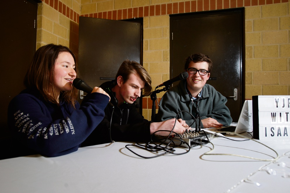 Isaac Mulcrone (right, 16), radio DJ and founder of Youth Jam Radio, pictured during broadcast at Somerly Primary School with Zoe Baxter (16) and Jack Smallacombe (17). Picture: Marie Nirme d474290
