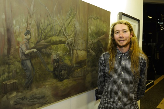 Artist Jarrad Martyn with his winning oil painting Territory.  The City of Joondalup exhibition is on at Lakeside Joondalup Shopping City until October 28.